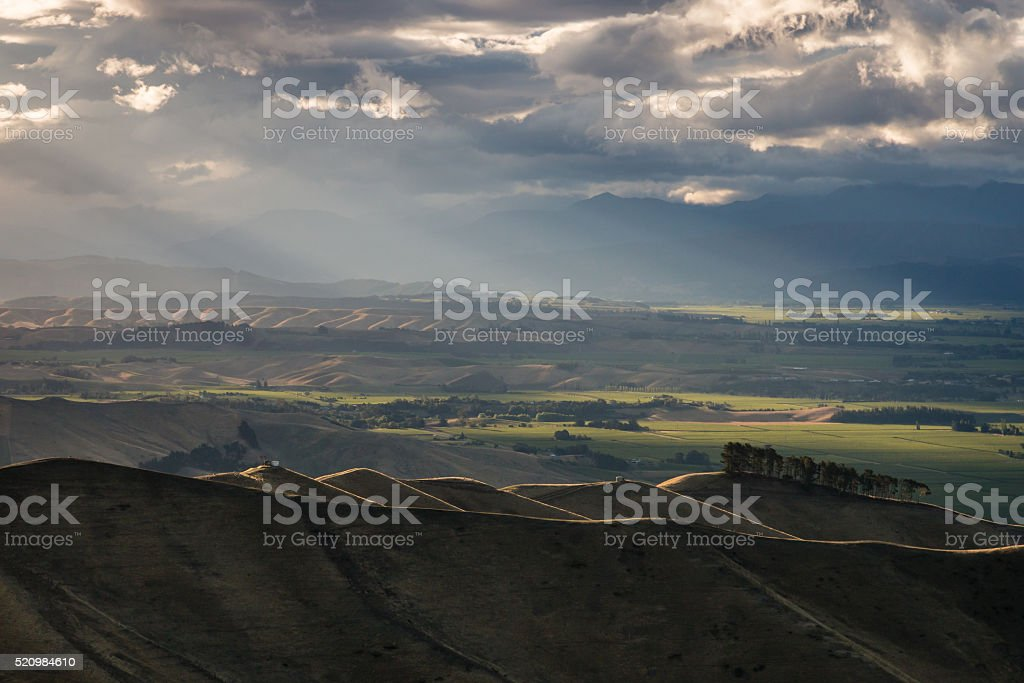 sunset over rolling hills stock photo