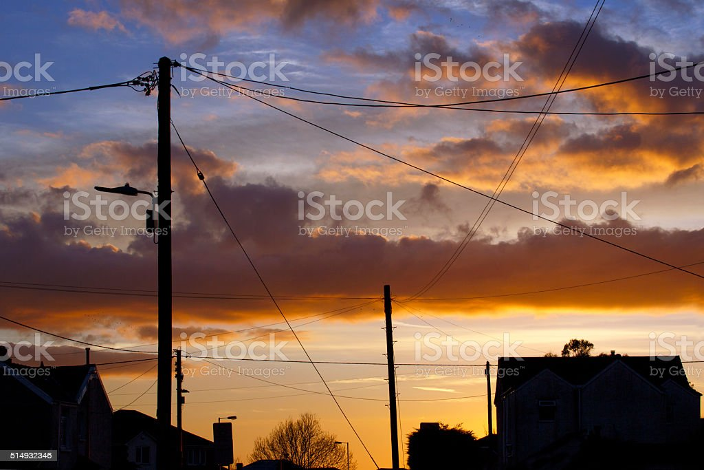 Sunset Over Rooftops - Silhouette stock photo