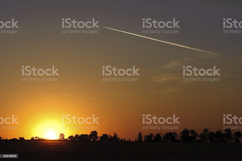 sunset over rural landscape royalty-free stock photo
