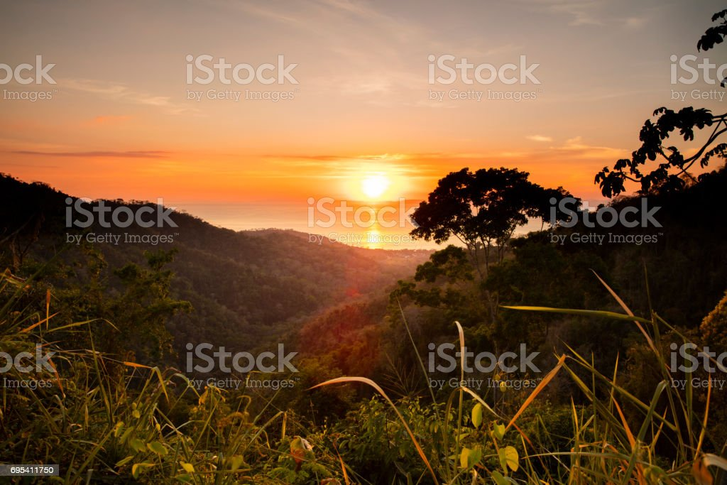 Sunset over sea and mountain in Cost Rica stock photo