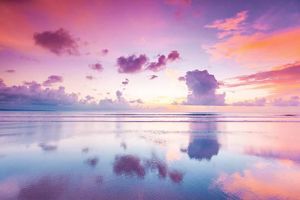 Sunset over sea on Bali stock photo