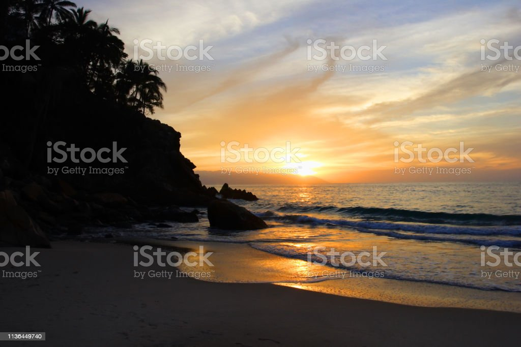 Sunset over sea waves stock photo