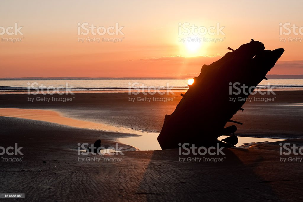 Sunset over shipwreck stock photo