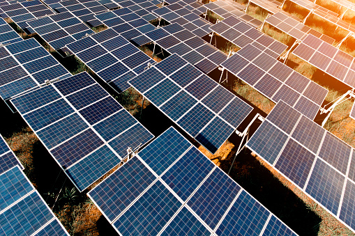 Sunset Over Solar Farm Stock Photo - Download Image Now
