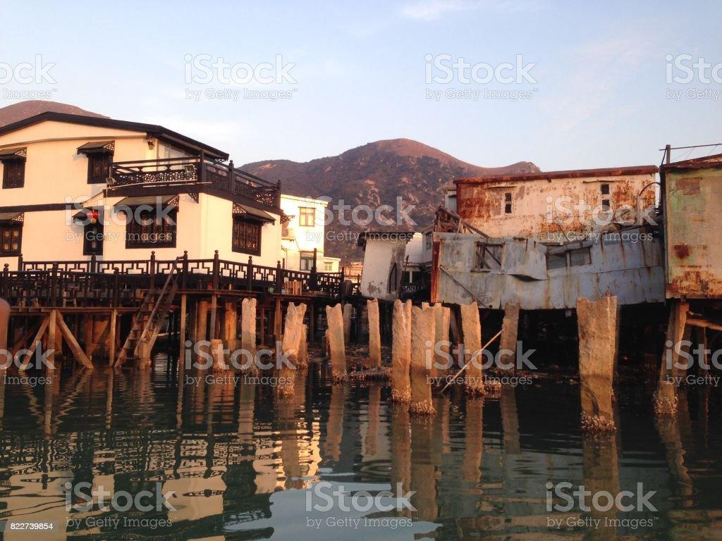 Sunset over stilt houses stock image