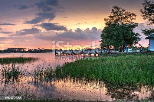 Sunset over Sugden Regional Park in Naples, Florida on Independence day.