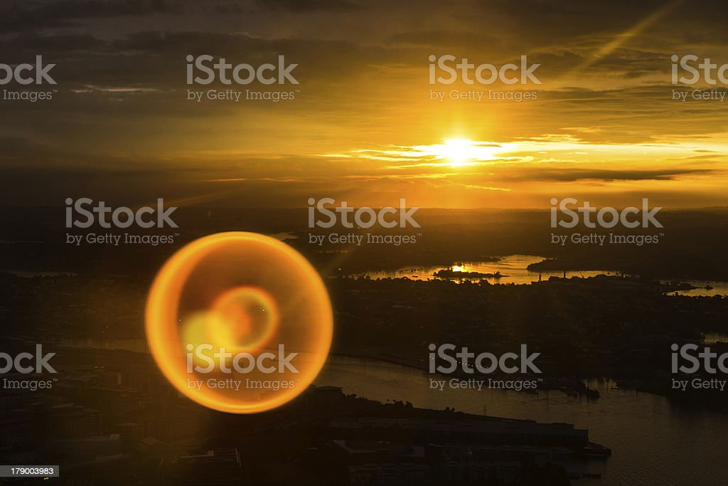 Sunset over Sydney with natural lens flare royalty-free stock photo