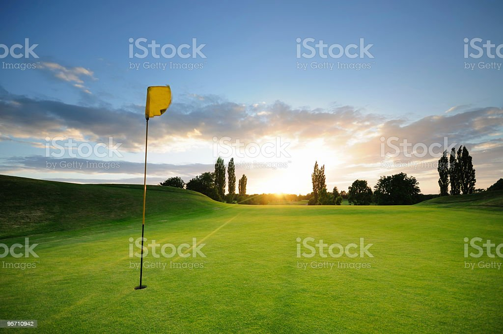 Sunset over the 18th stock photo