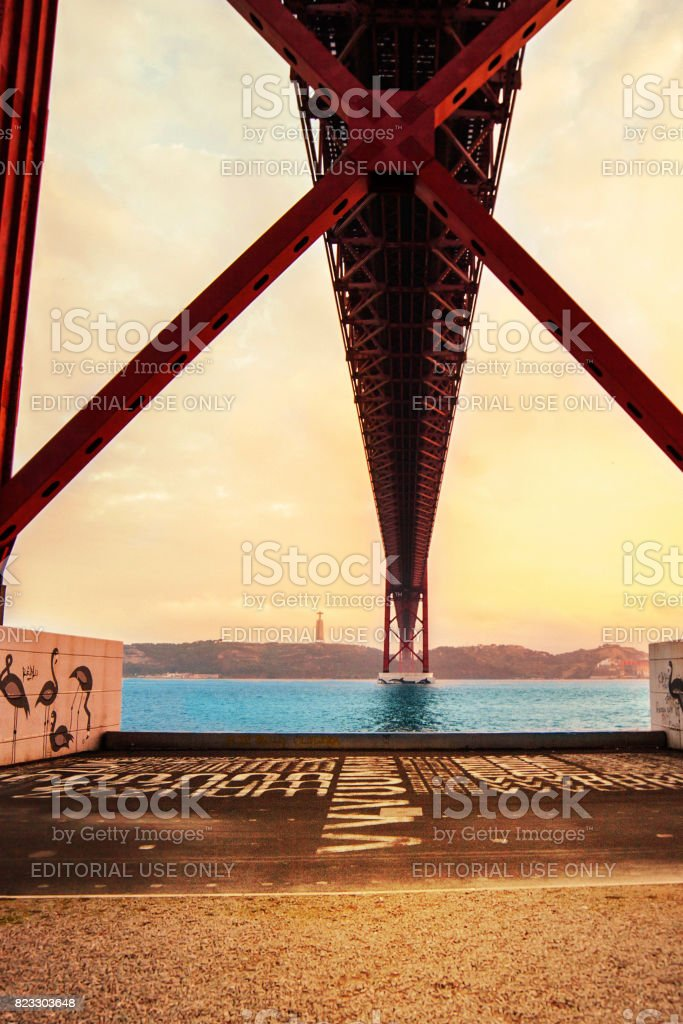 LISBON, PORTUGAL - October 21, 2016: Sunset over the 25 de Abril bridge over Tagus river and Christ monument in Lisbon, Portugal stock photo