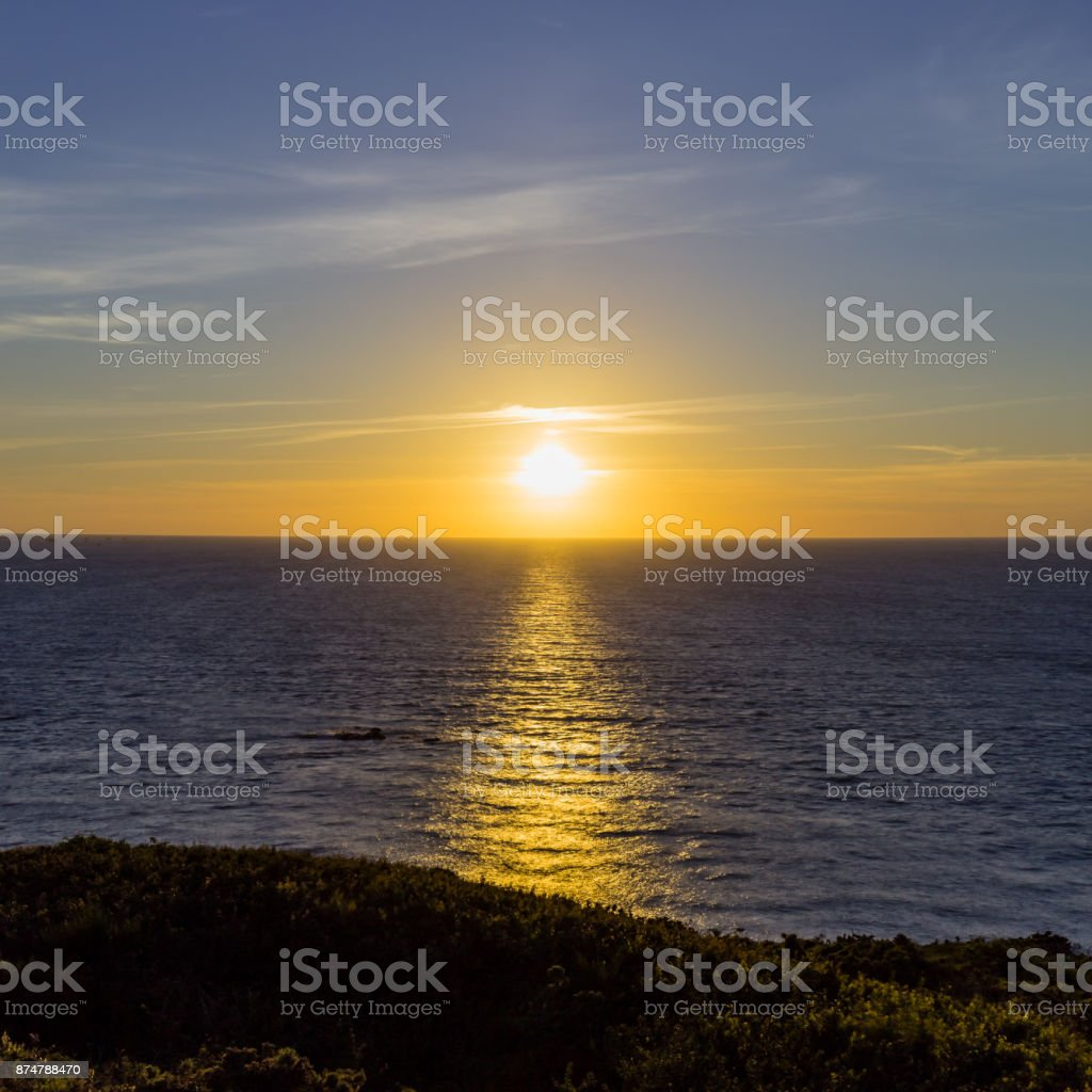 sunset over the Atlantic Ocean in Creac'h Maout stock photo
