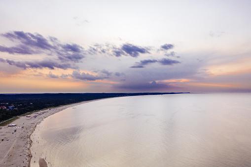 Sunset over the baltic sea coastline.
