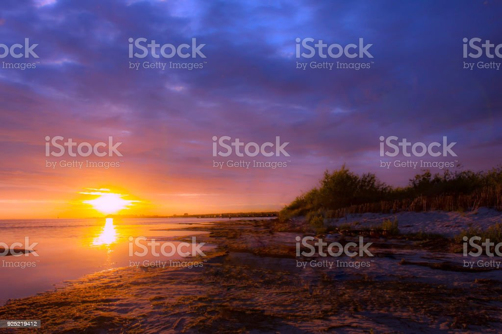 Sunset over the bay Picturesque sunset over the bay with an interesting sky Abstract Stock Photo