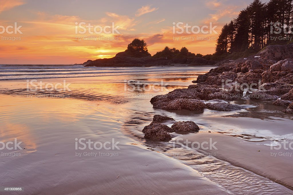 Sunset over the beach of Cox Bay, Vancouver Island, Canada stock photo