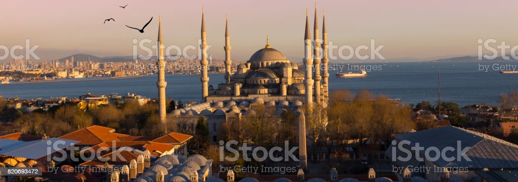 Sunset over The Blue Mosque, (Sultanahmet Camii), Istanbul, Turkey. stock photo