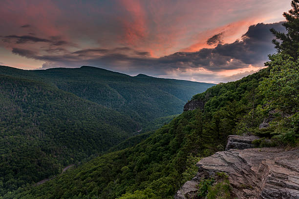 Sunset Over the Catskill Mountains Coloful sunset over the Kaaterskill Clove in the Catskill Mountains of New York catskill mountains stock pictures, royalty-free photos & images