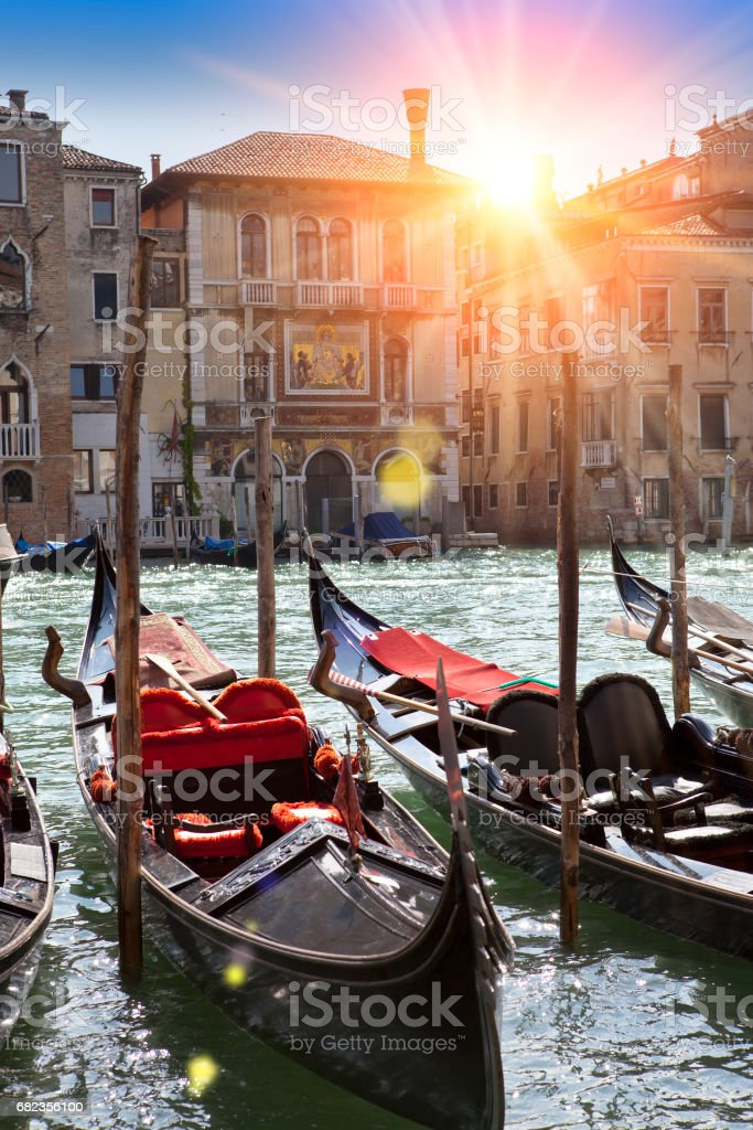 A sunset over the channel and gondolas, Venice, Italy royaltyfri bildbanksbilder