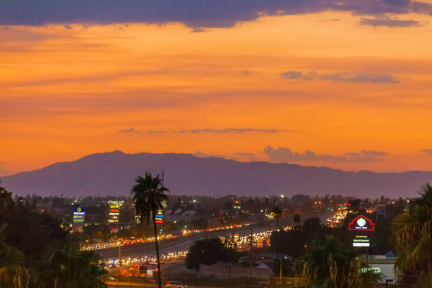 sunset over the city of burbank ca - san fernando valley stock photos and pictures
