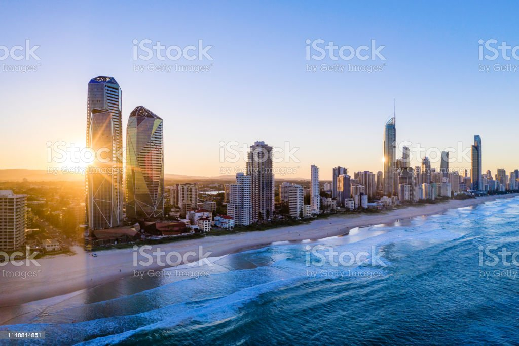 Sunset over the city of Gold Coast looking from the south Sunset over the city of Gold Coast looking from the south, Queensland, Australia Aerial View Stock Photo