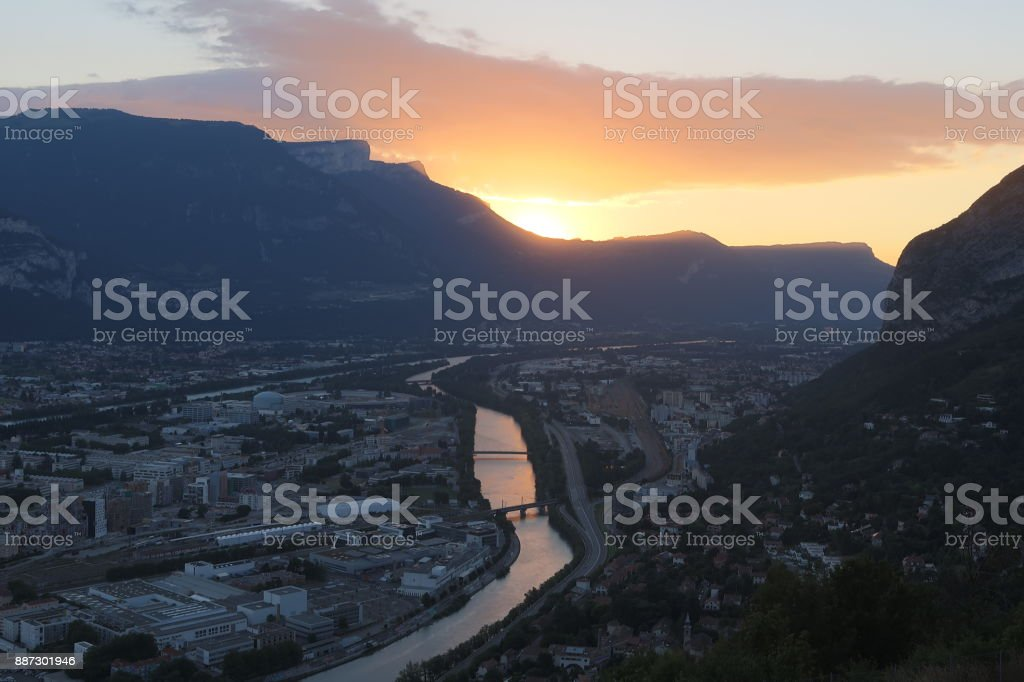 Sunset over the city of Grenoble stock photo