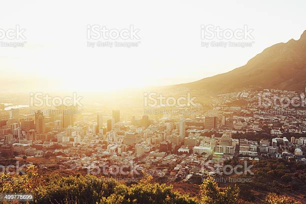 High angle view of the sun setting over the city of Cape Town