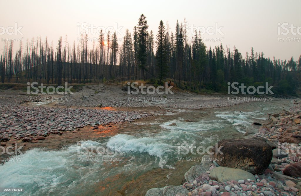 Sunset over the confluence of the South Fork of the Flathead River and Lost Jack Creek at Meadow Creek Gorge in the Bob Marshall Wilderness complex during the 2017 fall fires in Montana United States stock photo