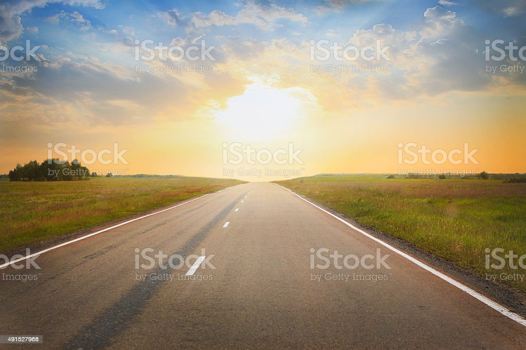 sunset over the country highway stock photo