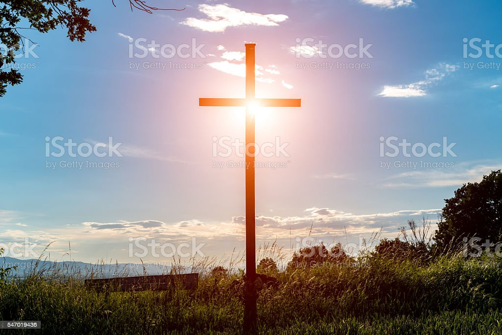 Sunset over the cross stock photo