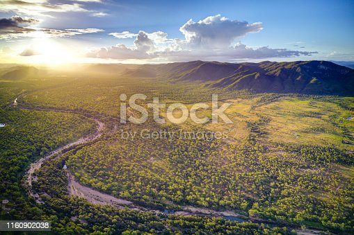 Sunset over the dry river bed of the Reid River, Townsville Charters Towers