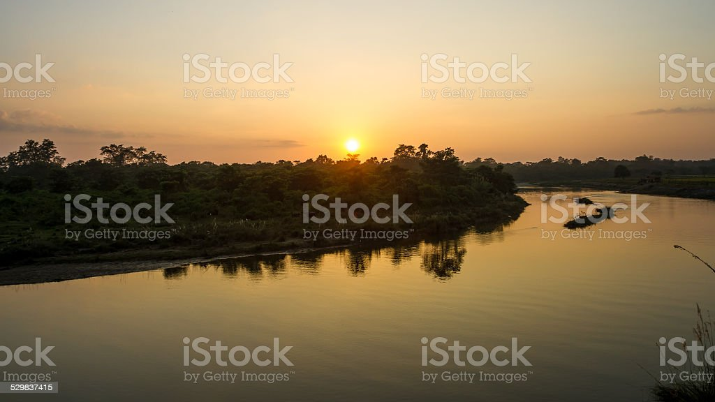Sunset Over the East Rapti River in Nepal stock photo