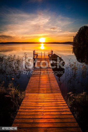 istock Sunset over the fishing pier at the lake in Finland 670026216