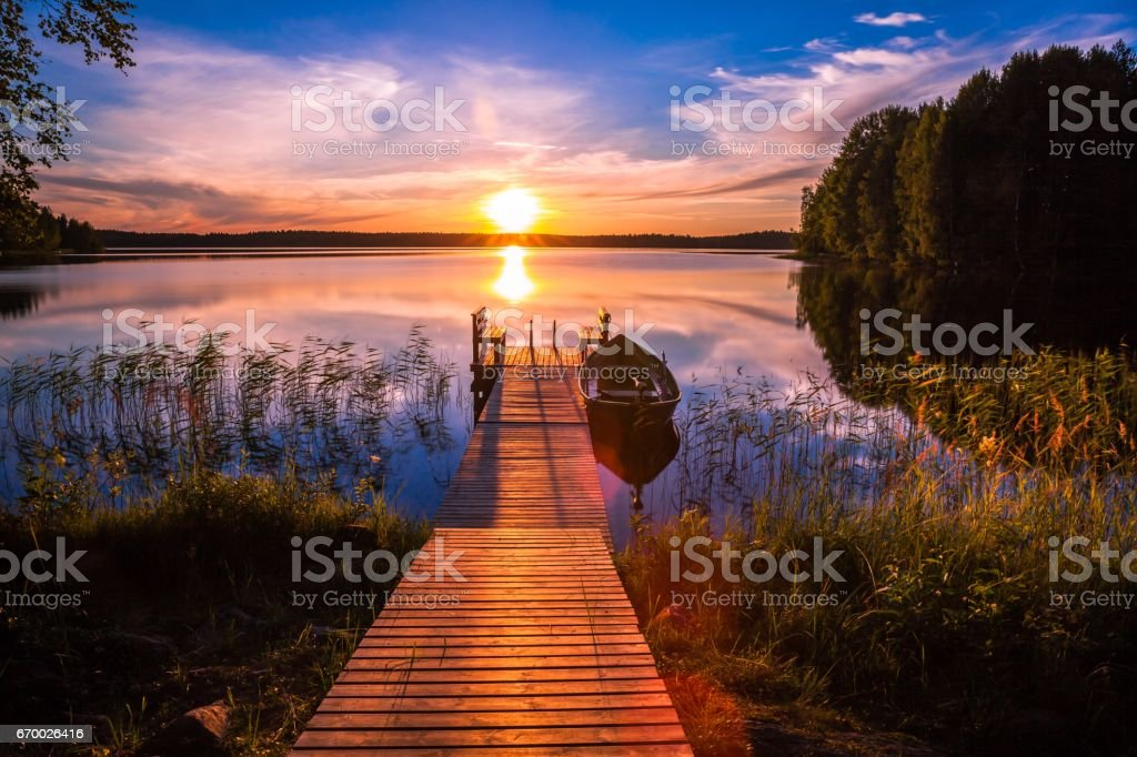 Sunset over the fishing pier at the lake in Finland stock photo