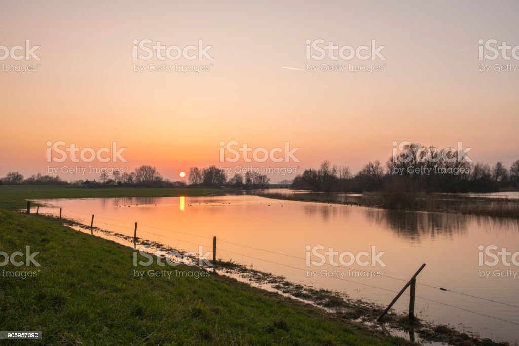 Sunset over the flooded overflow area of the river IJssel in The Netherlands stock photo