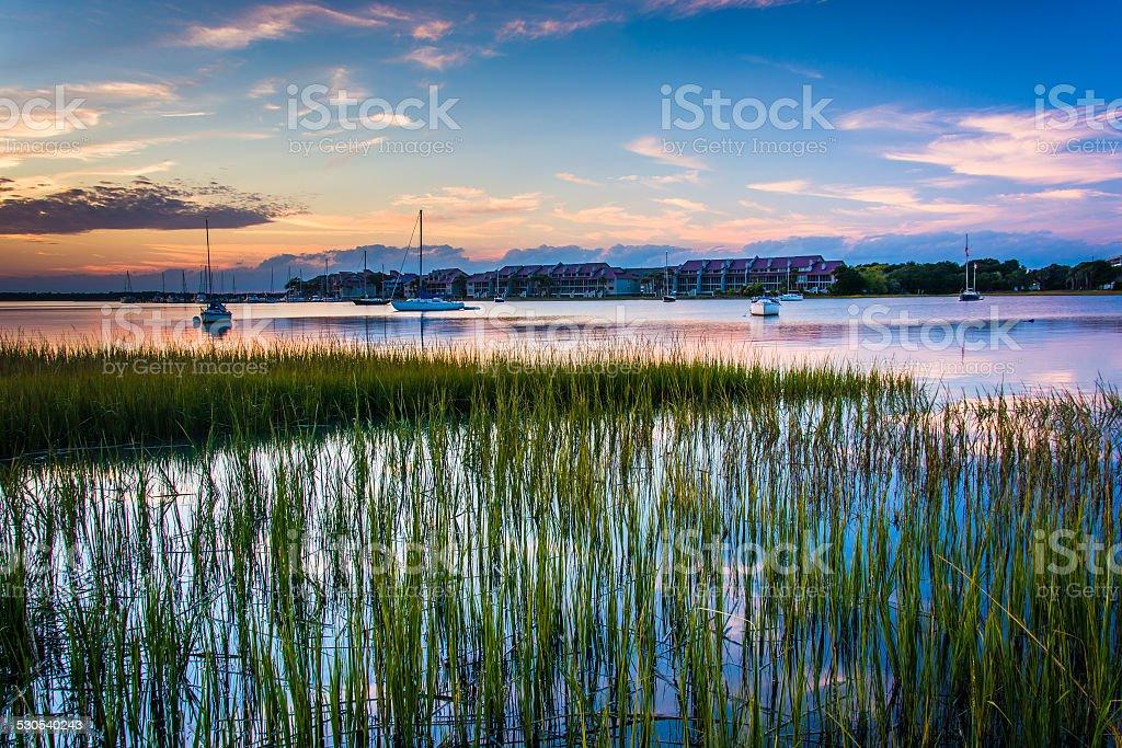 Sunset over the Folly River, in Folly Beach, South Carolina. stock photo