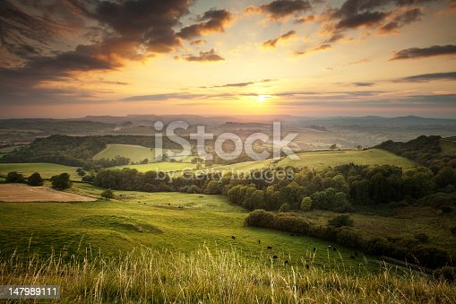 istock Sunset over the green hills countryside in England, Dorset 147989111