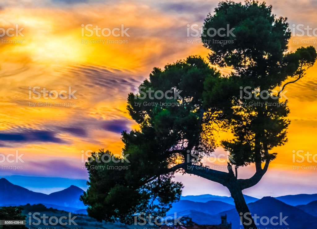 Sunset over the hills surrounding the Pamplona basic. Pamplona (Iruña), the historical capitalof Navarre, Spain, Famous for the running of the bulls during the San Fermin festival brought to literary renown by Ernest Hemingway's novel The Sun Also Rises. stock photo