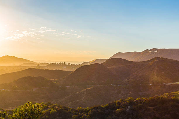 Sunset over the Hollywood sign from Griffith Observatory Sunset over the Hollywood Hills showing the Hollwood sign on a beautiful evening. hollywood california stock pictures, royalty-free photos & images
