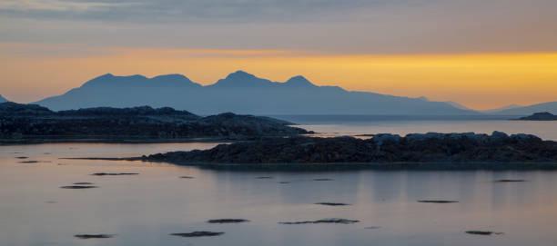 Sunset over the Isle of Rum, Scotland stock photo