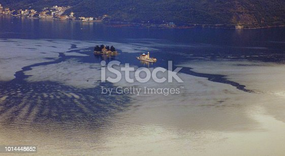 istock Sunset over the Kotor bay, with Our-Lady-of-the-Reef and Saint-George island 1014448652