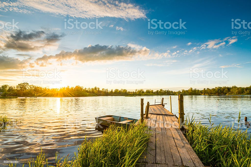 Sunset over the lake in the village