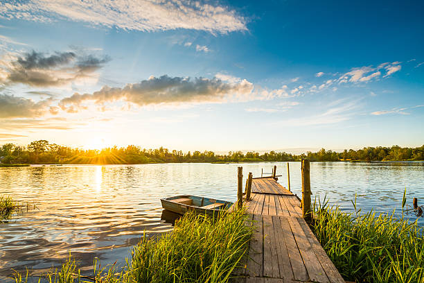 Sunset over the lake in the village stock photo