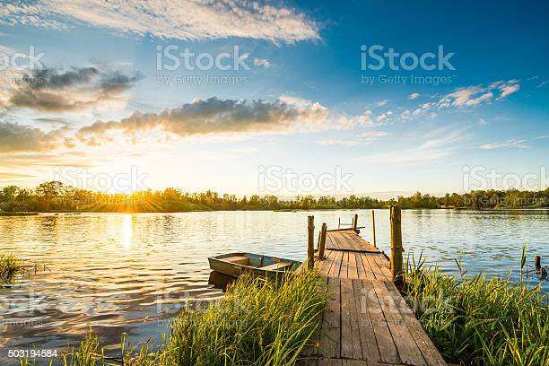 Photo of Sunset over the lake in the village