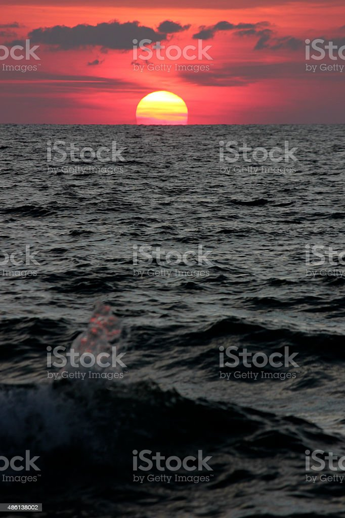 Sunset over the Mediterranean Sea The Sun sets over the Mediterranean Sea in Sardinian's Costa Paradiso. 2015 Stock Photo