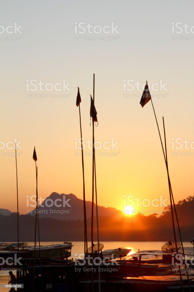 Sunset over the Mekong river in Luang Prabang in Laos stock photo