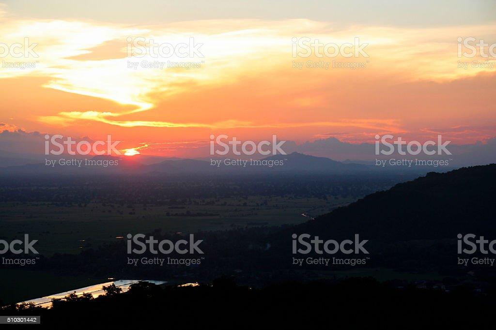 Sunset over the mountains in Battambang stock photo