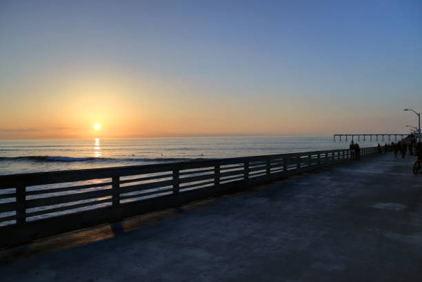 sunset over the ocean beach pier near san diego, california - oceano pacifico occidentale foto e immagini stock