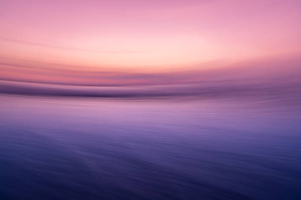 Sunset over the ocean. Blurred abstract background. stock photo
