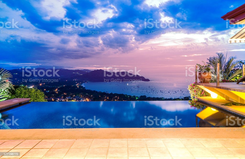 Sunset over the ocean from the patio stock photo