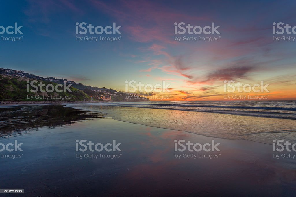 Sunset over the Ocean with Beautiful Clouds stock photo