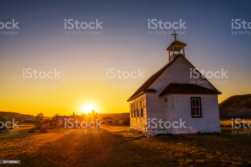 Sunset over the old church in the ghost town of Dorothy stock photo