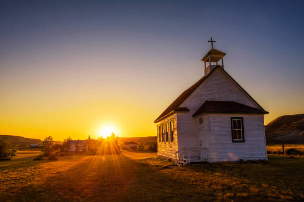 sunset over the old church in the ghost town of dorothy - church stock photos and pictures